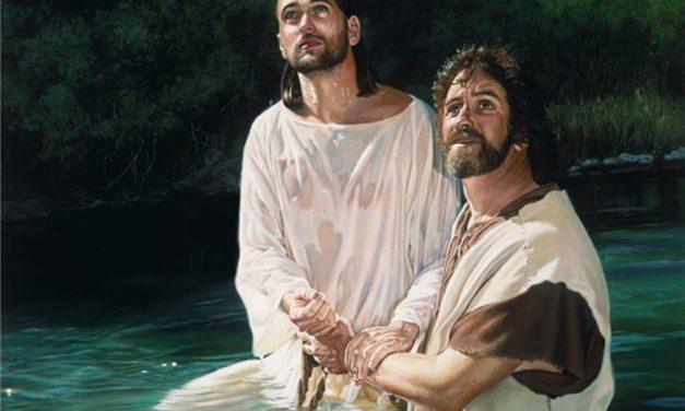 Jesus is baptised in the River Jordan by John the Baptist